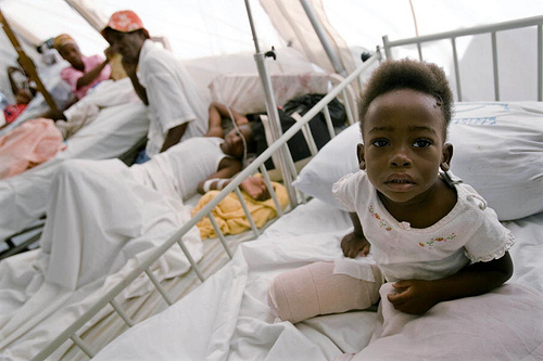 A child amputee sits up in her hospital bed in Jacmel, Haiti. UN Photo/Marco Dormino. www.un.org/av/photo/