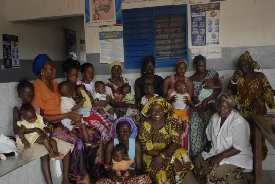 Awa Diagne (seated, far right) and her volunteer colleagues care for new mothers and infants.
