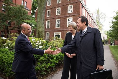 John Paulson (right) and Harvard President Drew Faust greet Harvard Business School Dean Nitin Nohria. (Credit: Rose Lincoln/Harvard Staff Photographer)